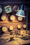 Watchmaker's workshop with many clocks. Closeup of watchmaker's workshop with many clocks Stock Image