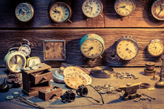 Watchmaker's workshop with parts of clocks Stock Image