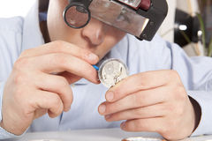 Watchmaker. Watch repair craftsman repairing watch Royalty Free Stock Images