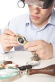 Watchmaker. Watch repair craftsman repairing watch Stock Images