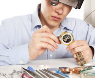 Watchmaker. Watch repair craftsman repairing watch Royalty Free Stock Image