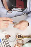 Watchmaker. Watch repair craftsman repairing watch Stock Image
