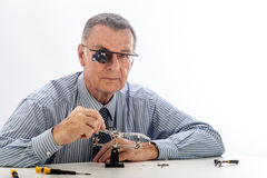 Watchmaker on White Background Royalty Free Stock Image