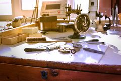 Watchmaker workshop. Workplace of watch repairer. Process of repair mechanical watches. stock photos
