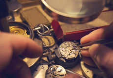 Watchmakers Craftmanship. A watch maker repairing a vintage automatic watch stock photos