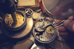 Watchmakers Craftmanship. A watch maker repairing a vintage automatic watch stock photography