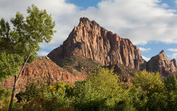 Watchman Peak at Sunset. The Watchman mountain in Zion National Park, Utah, United States at sunset in autumn with clouds in the sky Stock Images
