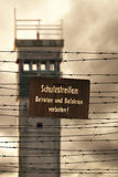 Watchtower with barbed wire and prohibition sign in East Germany Stock Photo