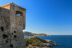 Watchtower in the citadel at Calvi, Corsica. A watchtower in the citadel at Calvi overlooking the Mediterranean and the lighthouse at La Revellata Stock Photo
