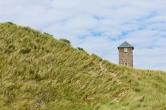 Watchtower in the dunes Royalty Free Stock Photography