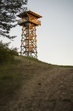 Watchtower on a hill. Wooden watchtower on big hill Royalty Free Stock Image