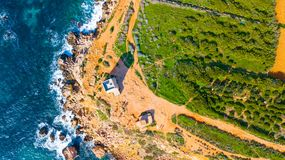Watchtower in Malta with sea from drone. Point of view Royalty Free Stock Photos