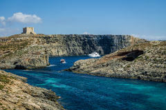 Watchtower near the Blue Lagoon in Comino Island - Gozo, Malta. Watchtower near the Blue Lagoon in Comino Island in Gozo, Malta Royalty Free Stock Photo