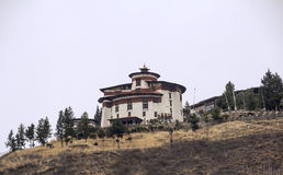 Watchtower of Paro Dzong. The watchtower of Paro Dzong is now a museum. Paro Dzong, like all dzongs is partly a government building and for the other part a Stock Images