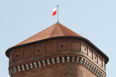 Watchtower with the Polish flag in the Wawel Castle in Krakow Royalty Free Stock Photo