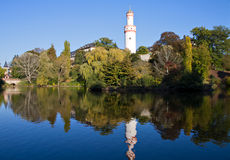 Watchtower reflecting in pond Stock Photos