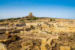 Watchtower and ruins of ancient Tharros in Sardinia Stock Image