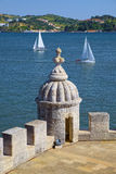 Watchtower and sailing boats Royalty Free Stock Image