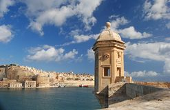 Watchtower in Senglea, Malta. A little watchtower in Senglea with Valletta in the background, Malta Royalty Free Stock Photography