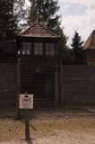 Watchtower and wire fence in Auschwitz-Birkenau Concentration Ca. Oswiecim, Poland - May 02, 2012: Watchtower and wire fence in Auschwitz-Birkenau Concentration Royalty Free Stock Image