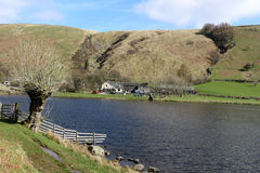 Watendlath Tarn, English Lake District, Cumbria. View North East across Watendlath tarn to Watendlath in the English Lake District, Cumbria, England. At the left Royalty Free Stock Images