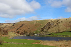 Watendlath Tarn and hamlet, English Lake District. View looking North East across Watendlath tarn to Watendlath hamlet and the fells beyond including High Seat royalty free stock images