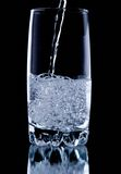 Water. Splash water in the glass on the black background Royalty Free Stock Images
