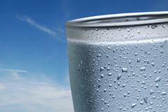 Water. Glass of cold water with blue sky in the background Royalty Free Stock Photos
