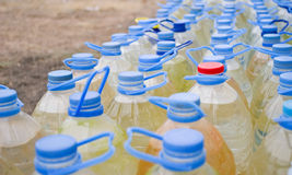 Water. Plastic bottles of dirty water Royalty Free Stock Image