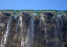 Water. Flowing down with sky background Stock Photo