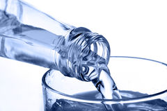 Water. Bottle pouring water into glass Royalty Free Stock Photography