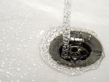 Water. Pouring out in a bathroom Royalty Free Stock Image