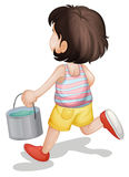 Water. Kid carrying a bucket of paint Royalty Free Stock Photography