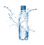 Water. Plastic bottle and water splashes and drops isolated on a white background Stock Photography