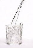 Water. Pouring water in glass - white background Royalty Free Stock Photos