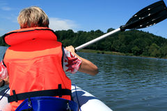 On the water. Woman kajaking on the  lake in Germany / Bavaria Stock Photography