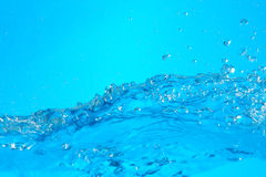 Water. Wave with splashing  and bubbles stock images
