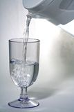 Water. Pouring water into a glass Stock Images
