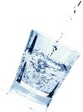 Water. Pouring into the glass Stock Image