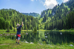 Water activity - fishing school in the Lake La Mouille in the French Alps Stock Image