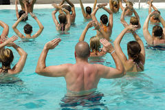 Water aerobic. People are doing water aerobic in pool Royalty Free Stock Image