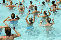 Water aerobic. People are doing aerobic in pool Stock Photos