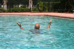 Water aerobics. A Man doing water aerobics Stock Photos