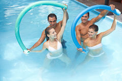 Water aerobics with swim noodles stock photography