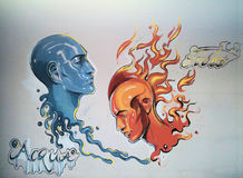 Water against fire & x28;two faces& x29;. Art painting with two heads representing the water and the fire Stock Image