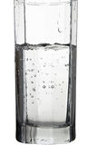 Water with air bubbles in a glass isolated on white. Background Royalty Free Stock Photo