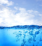 Water and air bubbles over sky background Royalty Free Stock Photos