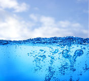 Water and air bubbles over sky background Stock Photo