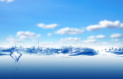 Water. And air bubbles over sky background Stock Photos