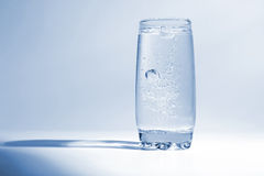 Water with air bubbles in transparent glass Stock Images